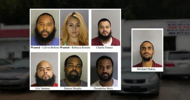 Five people are under arrest and police are searching for two more in connection with a pair of violent robberies of a used car dealership in Montgomery County.