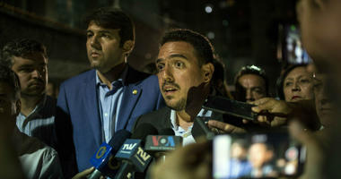 Opposition Deputy of the National Assembly Stalin Gonzalez talks to journalists at the Democratic Action political party headquarters in Caracas, Venezuela, Wednesday, May 8, 2019