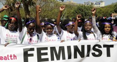 Kenyan women shout slogans during a march to mark International Women's Day in Nairobi, Kenya, Friday March 8, 2019.