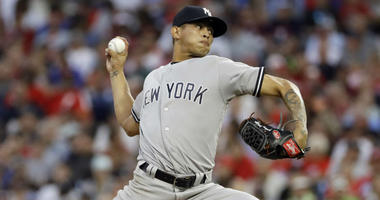 New York Yankees' Jonathan Loaisiga pitches during the fourth inning of a baseball game against the Philadelphia Phillies, Monday, June 25, 2018, in Philadelphia.