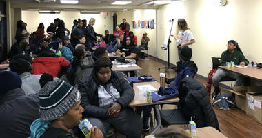 Volunteers gather count homeless young people in Philadelphia.