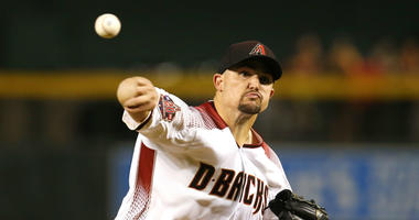 Arizona Diamondbacks pitcher Zack Godley throws in the first inning during a baseball game against the Philadelphia Phillies, Monday, Aug. 6, 2018, in Phoenix.