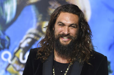 """FILE - In this Dec. 12, 2018 file photo, Jason Momoa arrives at the premiere of """"Aquaman"""" at TCL Chinese Theatre in Los Angeles. Momoa on Wednesday, April 17, 2019 released a video in which he shaved off his signature beard and mustache in order to promot"""