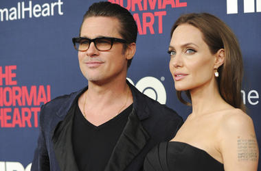 "Brad Pitt and Angelina Jolie attend the premiere of HBO Films' ""The Normal Heart"" at the Ziegfeld Theatre in New York. Jolie and Pitt are officially single, though more work is left before the terms of their divorce are final. Los Angeles Superior Court d"