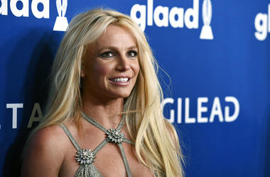 This April 12, 2018, file photo shows Britney Spears at the 29th annual GLAAD Media Awards in Beverly Hills, Calif. A Los Angeles judge will consider whether to extend a temporary restraining order Tuesday, May 28, 2019, that keeps Sam Lutfi, a former ass