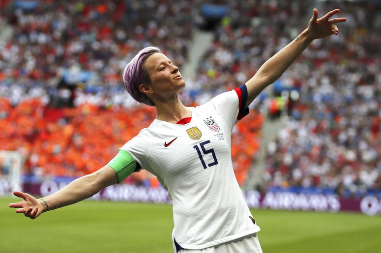 United States' Megan Rapinoe celebrates after scoring the opening goal from the penalty spot during the Women's World Cup final soccer match between US and The Netherlands at the Stade de Lyon in Decines, outside Lyon, France, Sunday, July 7, 2019. (AP Ph