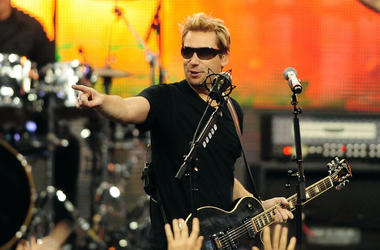 Nickelback recording artist Chad Kroeger performs during halftime of the Thanksgiving game between the Detroit Lions and the Green Bay Packers at Ford Field.