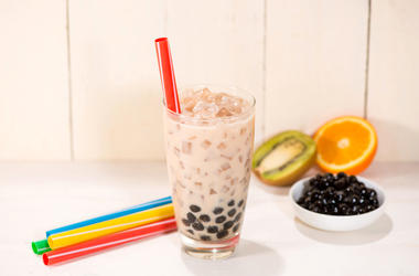A glass of bubble tea with milk