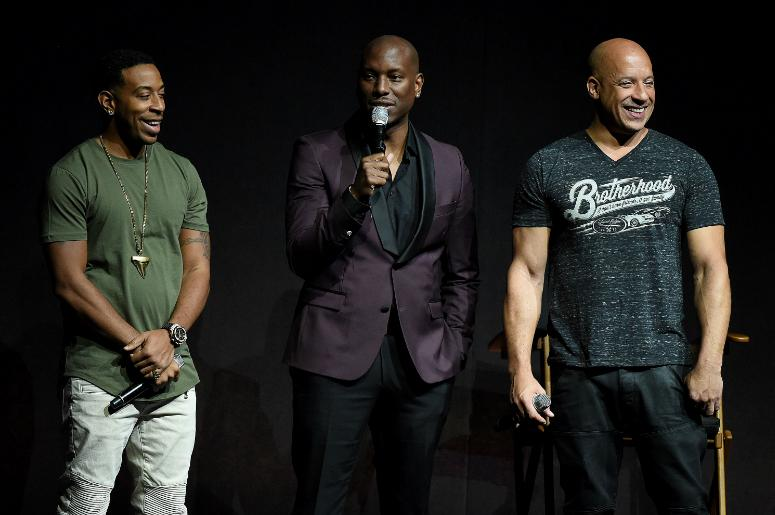 Ludacris, Tyrese Gibson, and Vin Diesel onstage at the CinemaCon 2017 Universal Pictures presentation.