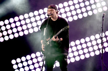 Michael Clifford of music group 5 Seconds of Summer performs onstage