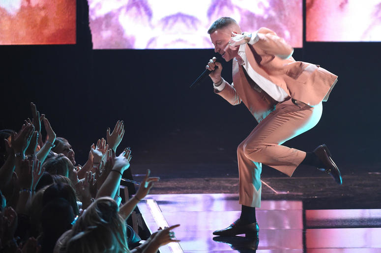 Macklemore performs at the 2017 American Music Awards