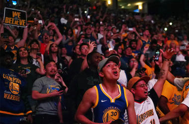 Jun 8, 2018; Oakland, CA, USA; Golden State Warriors fans celebrate after the win at the watch party for game four of the 2018 NBA Finals at Oracle Arena. Mandatory Credit: Kelley L Cox-USA TODAY Sports