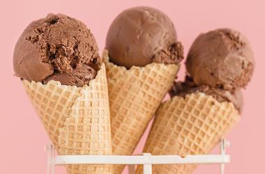 Delicious pastel color chocolate ice cream cones behind tender pink modern background. (Photo credit: Valeria Aksakova/Dreamstime)