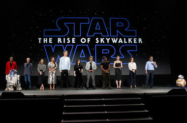 ANAHEIM, CALIFORNIA - AUGUST 24: (L-R) Billy Dee Williams, Anthony Daniels, Keri Russell, Naomi Ackie, Joonas Suotamo, Kelly Marie Tran, Oscar Isaac, John Boyega, Daisy Ridley, Producer Kathleen Kennedy, and Director/producer/writer J.J. Abrams of 'Star W