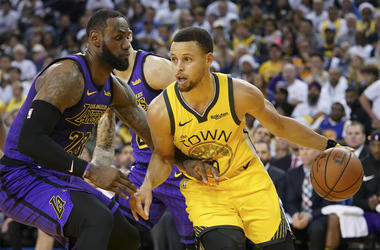 December 25, 2018; Oakland, CA, USA; Golden State Warriors guard Stephen Curry (30) dribbles the basketball against Los Angeles Lakers forward LeBron James (23) during the third quarter at Oracle Arena. Mandatory Credit: Kyle Terada-USA TODAY Sports