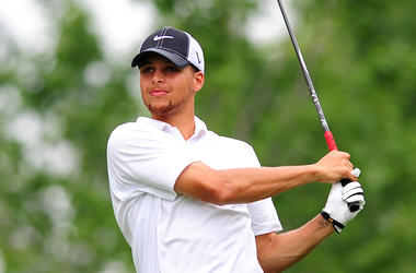 Golden State Warriors' Stephen Curry watches his drive during the Hooptee Celebrity Golf Classic at the Golf Club at Ballantyne in Charlotte, North Carolina, on Thursday, July 12, 2012. (Photo by Jeff Siner/Charlotte Observer/MCT/Sipa USA)