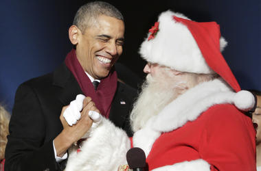 4 December 2014- Washington DC- U.S. President Barack Obama greets Santa Claus at the lighting of the National Christmas Tree. (Photo By Chris Kleponis/ISP/Sipa USA)