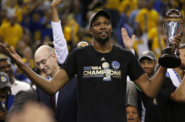 The Golden State Warriors' Kevin Durant holds the Finals MVP trophy after defeating the Cleveland Cavaliers, 129-120, in Game 5 of the NBA Finals at Oracle Arena in Oakland, Calif., on Monday, June 12, 2017.