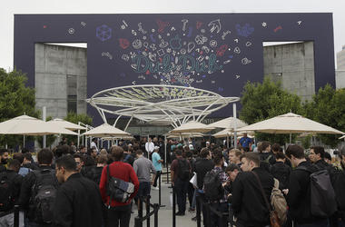 A crowd waits in line before an announcement at the Apple Worldwide Developers Conference in San Jose, Calif., Monday, June 3, 2019. (AP Photo/Jeff Chiu)