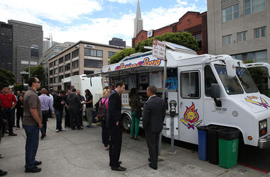 SAN FRANCISCO, CA - JULY 07: Customers line up to order food from the Senor Sisig food truck during an Off the Grid 'market' on July 7, 2014 in San Francisco, California. Popular San Francisco Bay Area food trucks are gathering at venues organzined by pla