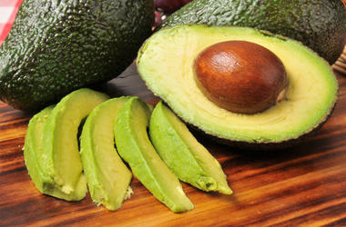 Sliced avocado on a cutting board (Photo credit: Getty Images)