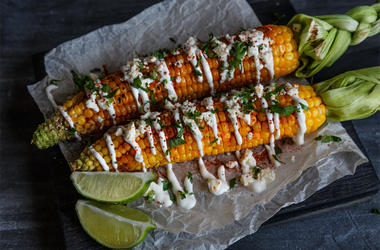 Elote or Mexican grilled corn on the cob served with cotija cheese and chili powder