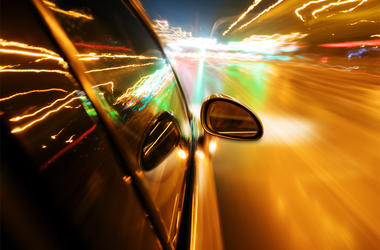 Night, high-speed car - stock photo A car driving on a motorway at high speeds, overtaking other cars
