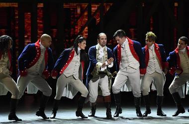 June 12, 2016; New York, NY, USA; Lin-Manuel Miranda (center) and the cast of 'Hamilton' perform during the 70th Tony Awards at the Beacon Theatre. Mandatory Credit: Robert Deutsch-USA TODAY NETWORK