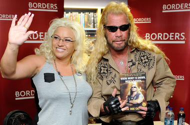 """NEW YORK - MARCH 19: Media personality Duane Chapman (right), known in the media as """"Dog the Bounty Hunter"""" is joined by his wife Beth Chapman as he promotes his book """"When Mercy Is Shown, Mercy Is Given"""" at Borders Wall Street on March 19, 2010 in New Yo"""