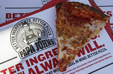 This Dec. 21, 2017, file photo shows a slice of cheese pizza at the Papa John's pizza shop in Quincy, Mass. Papa John's plans to pull Schnatter's image from marketing materials after reports he used a racial slur. Schnatter apologized Wednesday, July 11,