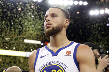 Confetti falls as Golden State Warriors' Stephen Curry walks off the court at the end of Game 5 of the team's NBA basketball second-round playoff series against the New Orleans Pelicans on Tuesday, May 8, 2018, in Oakland, Calif. Golden State won 113-104