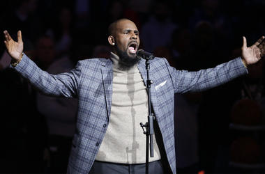 In this Nov. 17, 2015, file photo, musical artist R. Kelly performs the national anthem before an NBA basketball game between the Brooklyn Nets and the Atlanta Hawks in New York. As critics of the singer seek to cancel his shows because of his alleged mis