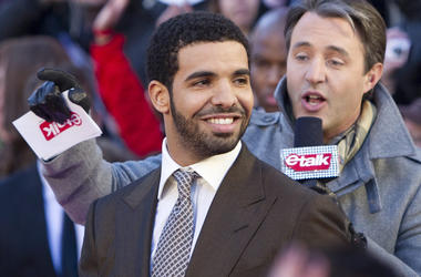 "In this March 27, 2011 file photo, Drake arrives on the red carpet at the 2011 JUNO Awards, Canada's music awards in Toronto. The 31-year-old rapper on Friday, June 29, 2018, released ""Scorpion."" In two songs on his fifth album, he addresses rumors that h"