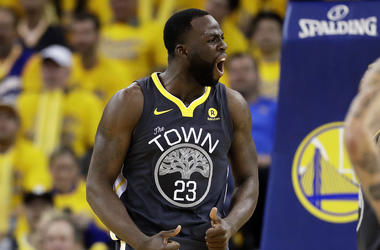 Golden State Warriors forward Draymond Green (23) reacts during the first half of Game 2 of basketball's NBA Finals between the Warriors and the Cleveland Cavaliers in Oakland, Calif., Sunday, June 3, 2018. (AP Photo/Marcio Jose Sanchez)
