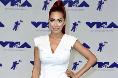 Farrah Abraham arrives at the MTV Video Music Awards in Inglewood, Calif. Police say the former reality TV star has been arrested after attacking a security guard at the Beverly Hills Hotel. Police say the security guard was asking Abraham to leave the ho