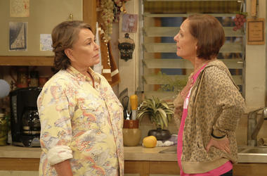 "In this image released by ABC, Roseanne Barr, left, and Laurie Metcalf appear in a scene from the reboot of the popular comedy series ""Roseanne."" ABC, which canceled its ""Roseanne"" revival over its star's racist tweet, said Thursday, June 21, 2018, it wil"