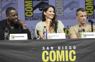 """Sterling K. Brown, from left, Olivia Munn and Thomas Jane attend the 20th Century Fox """"Predator"""" panel on day one of Comic-Con International on Thursday, July 19, 2018, in San Diego.(Photo by Richard Shotwell/Invision/AP)"""