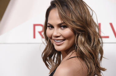In this Nov. 2, 2017, file photo, model Chrissy Teigen poses at the 2017 Revolve Awards at the Dream Hollywood hotel in Los Angeles. Teigen said people have been mispronouncing her last name for years and she hasn't corrected them. But the model took to s