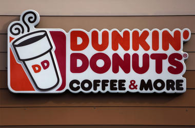 "In this Jan. 22, 2018, file photo shows the Dunkin' Donuts logo on a shop in Mount Lebanon, Pa. Dunkin' is dropping the donuts — from its name, anyway. Doughnuts are still on the menu, but the company is renaming itself ""Dunkin'"" to reflect its increasing"
