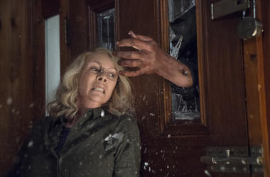 """This image released by Universal Pictures shows Jamie Lee Curtis in a scene from """"Halloween,"""" in theaters nationwide on Oct. 19. (Ryan Green/Universal Pictures via AP)"""