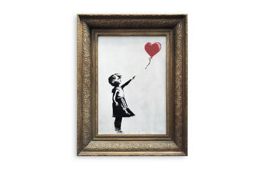In this undated photo provided by Sotheby's the spray-painted canvas 'Girl with Balloon' by artist Banksy is pictured. Art prankster Banksy has struck again. A work by the elusive street artist self-destructed in front of startled auction-goers on Friday,