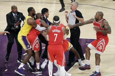 Houston Rockets' Chris Paul, second from left, is held back by Los Angeles Lakers' LeBron James, left, as Paul fights with Lakers' Rajon Rondo, center obscured, during the second half of an NBA basketball game Saturday, Oct. 20, 2018, in Los Angeles. The