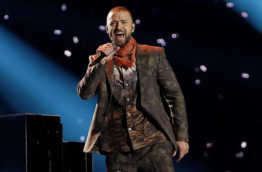 "In this Feb. 4, 2018 file photo, Justin Timberlake performs during halftime of the NFL Super Bowl 52 football game in Minneapolis. Timberlake says he is postponing his Wednesday night concert in New York City because his vocal chords are ""severely bruised"