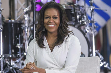 """In this Oct. 11, 2018 file photo, Michelle Obama participates in the International Day of the Girl on NBC's """"Today"""" show in New York. Oprah Winfrey and Reese Witherspoon will be among the special guests when Michelle Obama goes on tour for her memoir """"Bec"""