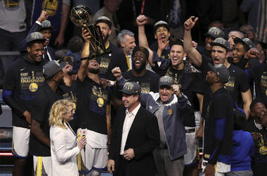 In this Friday, June 8, 2018, file photo, the Golden State Warriors celebrate after defeating the Cleveland Cavaliers 108-85 in Game 4 of basketball's NBA Finals to win the NBA championship, in Cleveland. The three-time NBA champion Golden State Warriors