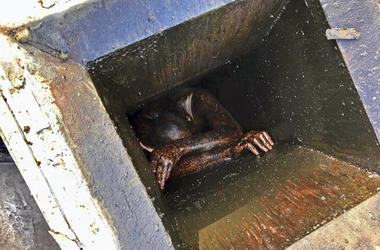 This photo provided by the Alameda County Sheriff's Office shows a man who was possibly trying to burglarize an abandoned Chinese restaurant in San Lorenzo, Calif., trapped in a grease vent before he was rescued Wednesday, Dec. 12, 2018. Officials say he