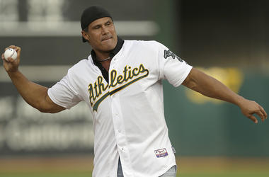 this Sept. 3, 2016, file photo, former Oakland Athletics player Jose Canseco throws out the ceremonial first pitch prior to a baseball game against the Boston Red Sox in Oakland, Calif. Canseco, a former major league slugger, has made his pitch for a big