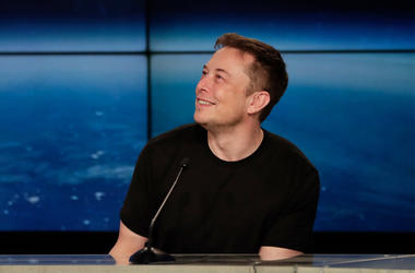 In this Feb. 6, 2018, file photo, Elon Musk, founder, CEO, and lead designer of SpaceX, speaks at a news conference from the Kennedy Space Center in Cape Canaveral, Fla. Musk is set to unveil an underground transportation tunnel that could move people fas