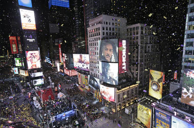 In this Jan. 1, 2018, file photo, confetti flies over Times Square during the New Year's celebration in New York. The New York Police Department is adding a drone this year to the security forces it uses to protect the huge crowds celebrating New Year's E