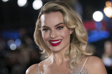 """In this Monday, Dec. 10, 2018, file photo, actress Margot Robbie poses for photographers upon her arrival at the premiere of the film """"Mary Queen of Scots,"""" in London. Robbie will bring the Barbie doll to life in a live-action film. Mattel and Warner Bros"""